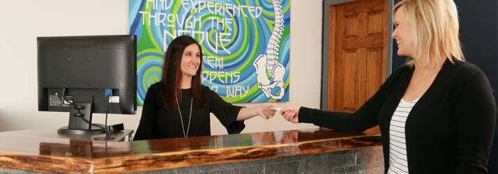 Chiropractic Dubuque IA Receptionist Helping Patient